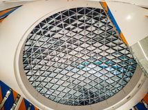 Oval shape modern ceiling. Perspective industrial background of grille ceiling bride and rooftop. Oval shape modern ceiling of exhibition hall with steel grille stock photo