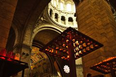 Perspective on the interior architecture of a cathedral. Perspective on the interior architecture of the Sacre Coeur cathedral in paris, from beneath the candles Royalty Free Stock Images