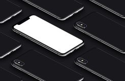 Similar to iPhone X perspective isometric smartphone mockup pattern on black surface. Similar to iPhone X perspective view isometric smartphones pattern mockup Royalty Free Stock Photos