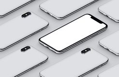 Similar to iPhone X perspective isometric smartphone mockup pattern on gray surface. Similar to iPhone X perspective view isometric smartphones pattern mockup Royalty Free Stock Photos