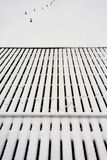 Perspective lines berth of wooden boards covered with snow in wi Royalty Free Stock Photography