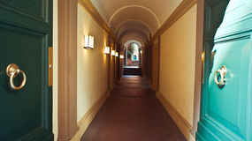 Perspective of the long corridor in hotel Royalty Free Stock Photography