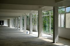 White pillars interior perspective. Perspective of a long interior hallway Royalty Free Stock Photography