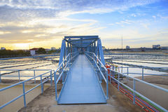 Perspective of metal bridge for working in big tank of water sup Stock Photos