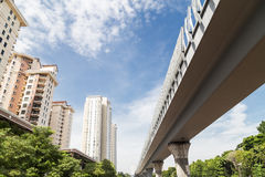 Perspective of modern high rise apartment with elevated rail lin Stock Photos