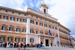 Perspective of Montecitorio in Rome during the day with visitors Royalty Free Stock Photo