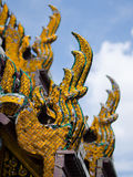 Perspective of Naga figures on a Thai temple roof for decoration Stock Image