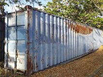 Free Perspective Of Old Rusty Container. Old Rusty Blue Shipping Container For Logistics And Transportation Royalty Free Stock Photo - 184066545