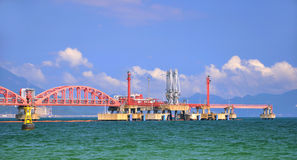 Perspective of oil transfer pipe line on sea Stock Photos