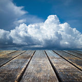 Perspective Old wood floor and cloudy sky Stock Photo