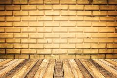 Perspective old wood on old brown brick wall for vintage retro b. Ackground and montage of your product Royalty Free Stock Image