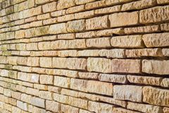 Perspective of old yellow brick wall Stock Photography