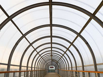 Perspective of the passage. Covered walkway over railway tracs Stock Photo