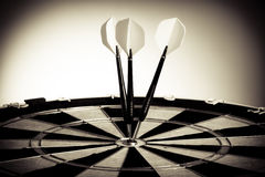 Perspective Photo Of Three Arrows On Darts Table Stock Photography