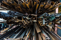 Perspective of pile of construction metals in factory Stock Images