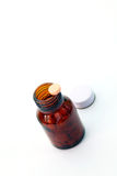 Perspective of pill on pill bottle Stock Photography