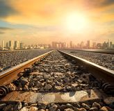 Perspective of railway track forward to building in city Royalty Free Stock Photography