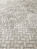 Perspective of rectangular blocks of embedded cement blocks. Perspective of pavement of rectangular blocks of cement embedded in diagonal zigzag pattern Royalty Free Stock Photos