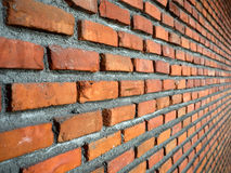 Perspective Red Brick Wall Background. /texture with cement paste and vignetting effect Royalty Free Stock Photography