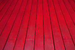 Perspective red wood floor texture background. Garlic isolated on white background Stock Photography