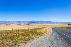 Perspective road view from South Africa, Dragon`s mountains Royalty Free Stock Photography