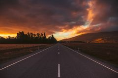 Perspective roadway in sunset sky stock photos