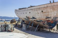 Perspective shot of back side fishing boat on ground for painting of trunk at Lesvos, Kalloni. At summertime stock photo