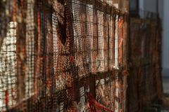 Perspective shot of a building site fence with shallow depth of field. A perspective shot of a building site fence with grid on it. Shallow depth of field, and royalty free stock image