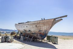 Perspective shot of fishing boat on ground for painting of trunk at Lesvos, Kalloni. At summertime stock photography
