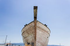 Perspective shot of front side fishing boat on ground for painting of trunk at Lesvos, Kalloni. At summertime stock photography
