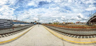 Perspective shot of a platform between two railway tracks going in opposite directions Royalty Free Stock Images