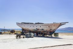 Perspective shot of side fishing boat on ground for painting of trunk at Lesvos, Kalloni. At summertime royalty free stock photo