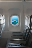 Perspective Shot of a Tropical Island through Passenger's Window Stock Photos