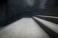 Perspective of the staircase and railing on concrete or marble walls. Royalty Free Stock Images