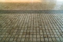 Perspective tiles floor. Perspective of brown tiles floor Royalty Free Stock Photo