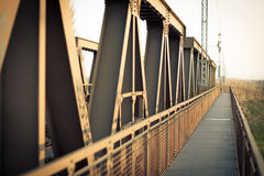 Perspective to infinity at the iron bridge Royalty Free Stock Photos