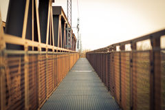 Perspective to infinity at the iron bridge. At sunset Royalty Free Stock Photos