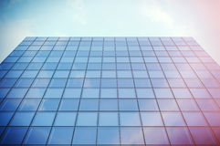 Perspective and underside angle view modern skyscraper business district in day light. Blue Skyscraper facade, office Royalty Free Stock Images
