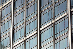 Perspective and underside angle view to textured background of contemporary glass building skyscrapers . Stock Photography