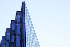 Perspective and underside angle view to textured background of contemporary glass building skyscrapers . Royalty Free Stock Image