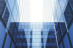 Perspective and underside angle view to textured background of modern glass blue building skyscrapers. Horizontal mockup Stock Photo