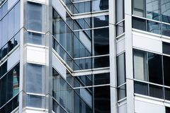 Perspective and underside angle view to textured background of modern glass building with reflections Royalty Free Stock Photos