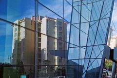 Modern glass silhouettes on modern building. Royalty Free Stock Images