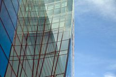 Perspective and underside angle view to textured background of modern glass building skyscrapers over blue cloudy sky Royalty Free Stock Photos