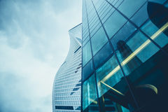 Perspective and underside of contemporary glass building skyscrapers at night Stock Photos