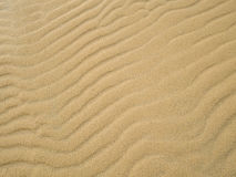 Perspective unique sand pattern. Beautiful sand texture background at beach.  stock photo