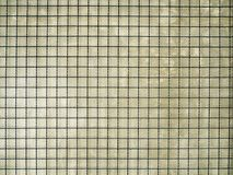 Perspective unique vintage grunge texture of cement wall cover with black steel metal net on top.  Royalty Free Stock Images