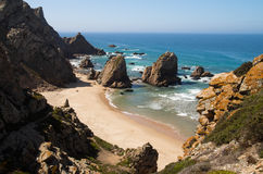 Perspective of Ursa Beach, Cape Roca. High perspective of Ursa Beach and its rocks facing the ocean. A remote naturist beach near Cape Roca, Sintra, Portugal stock photo