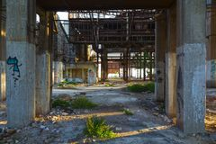 Perspective view of an abandoned industrial factory in Greece. Perspective view of an abandoned industrial factory, creepy interior at Piraeus, Greece Royalty Free Stock Photos