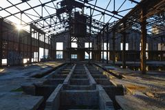 Perspective view of an abandoned industrial factory in Greece. Perspective view of an abandoned industrial factory, creepy interior at Piraeus, Greece Royalty Free Stock Photo
